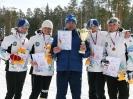Лыжницы сборной Югры и тренер сборной Александр Халямин